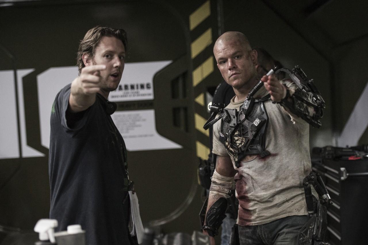 Photo: Kimberly French / Director Neill Blomkamp and Matt Damon on set